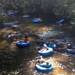 group floating down the river